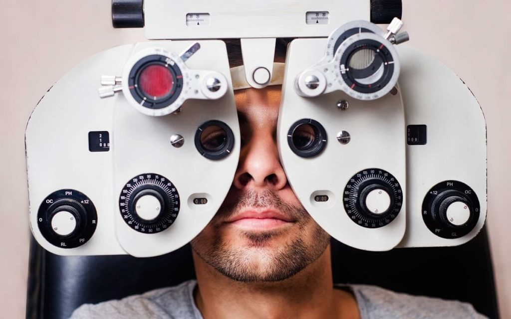 A man having his eyes examined with medical equipment.