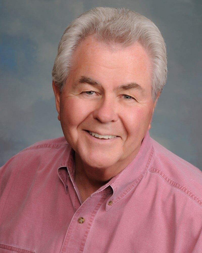 First vice chair, Richard Dewar. He is wearing a pink button down.