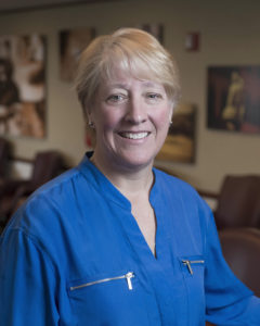 Vice President of Rehabilitation, Kathy Beaver. She is smiling and wearing a blue shirt.,