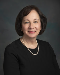 A headshot of CABVI board member, Doctor Cynthia J. Parlato. She is wearing a black dress and a pearl necklace.