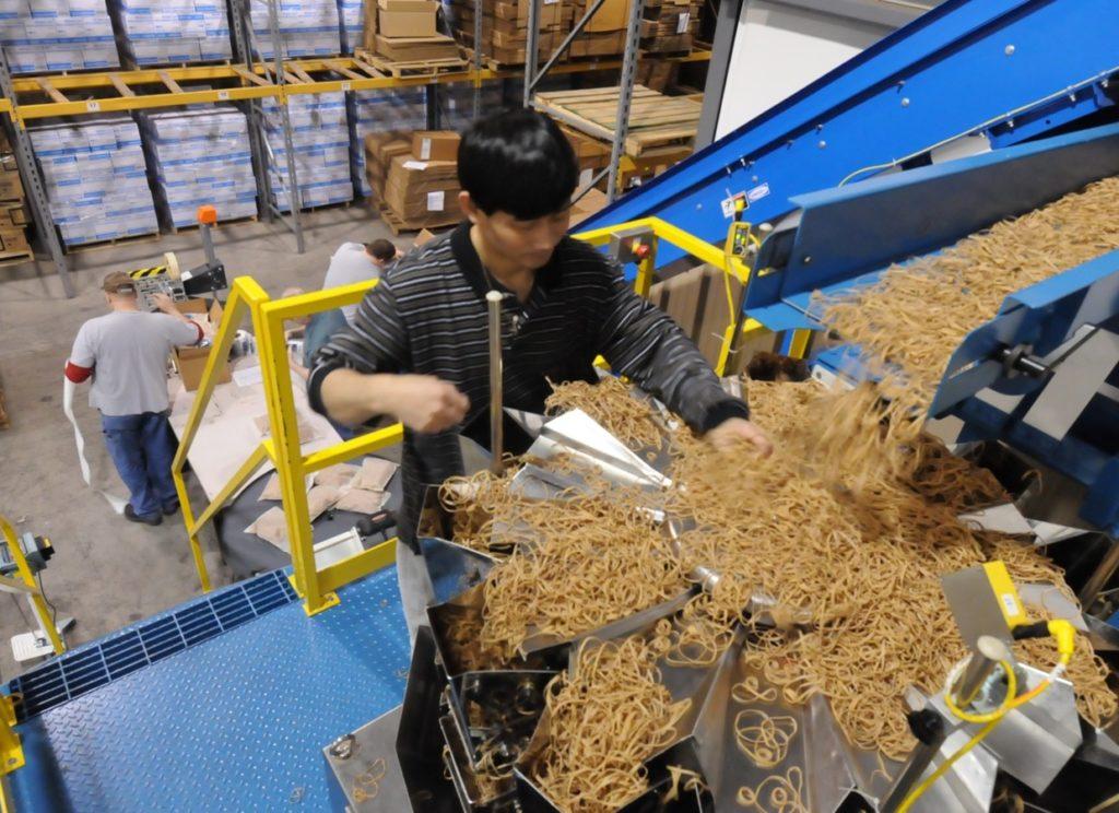 An employee using the rubberband machine.