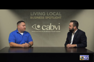 Al and Alex discussing CABVI with the logo in the middle