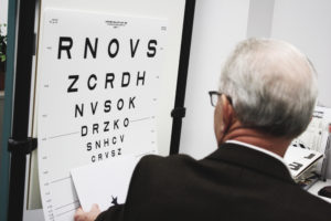 a low vision doctor showing the low vision chart