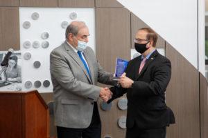 Senator Joe Griffo accepts an award from CABVI chairman Jim Turnbull